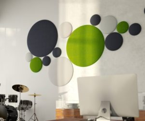 Circular acoustic panels in green, charcoal and white