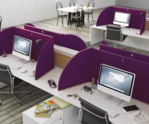 Desktop privacy screens in office workplace