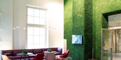 Pixel Moss blankets a high wall
